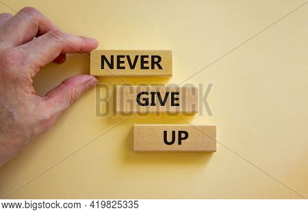 Never Give Up Symbol. Wooden Blocks With Words 'never Give Up'. Beautiful White Background. Business