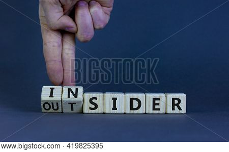 Insider Or Outsider Symbol. Businessman Turns A Cube, Changes The Word 'insider' To 'outsider' Or Vi