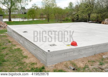 Cement Foundation Of A New House On A Construction Site. Laying A Concrete Foundation