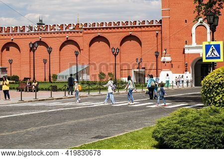 Moscow, Russia - 06 14 2016: Tourists Inside Of Moscow Kremlin Crossing The Road Coming From Spasska