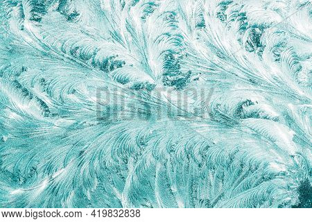 Blue Frosty Glass Ice Background, Natural Beautiful Snowflakes Frost Ice Pattern. Winter Xmas Christ