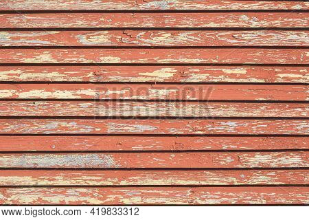 Aged Natural Old Red Color Obsolete Wooden Board Background. Grungy Vintage Wooden Surface. Painted