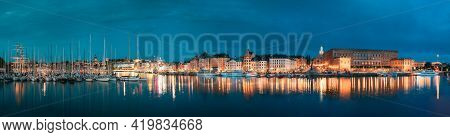 Stockholm, Sweden. Scenic Famous View Of Embankment In Old Town Of Stockholm In Night Lights. Gamla