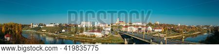 Grodno, Belarus. Grodno Regional Drama Theater And Catholic Church Of Discovery Of Holy Cross And Be