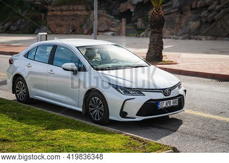 Alanya, Turkey - April 17 2021: White  Toyota  Corolla Is Parked  On The Street On A Warm Summer Day