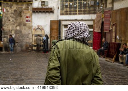 Street View, Downtown Damascus, Syria Featuring A Man From Behind Wearing A Palestinian Style Keffiy