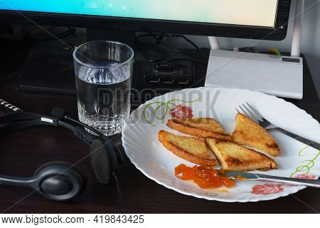Crispy And Golden Toast With Mango Jam, And A Glass Of Water.