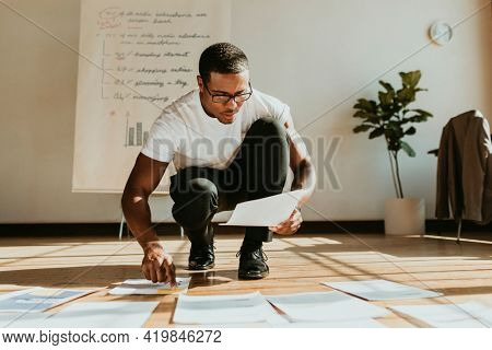 Businessman planning a marketing strategy on a wooden floor