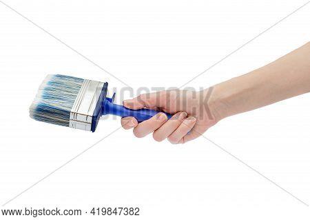 Woman's Hand Holding Paintbrush. Isolated On White.