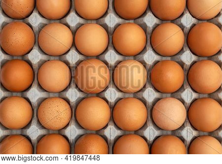 Food Background Of Eggs In Carton Tray. Close U