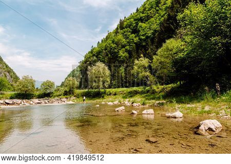 Hiking In European Alps At Lake With Beautiful Mountains And Scenery