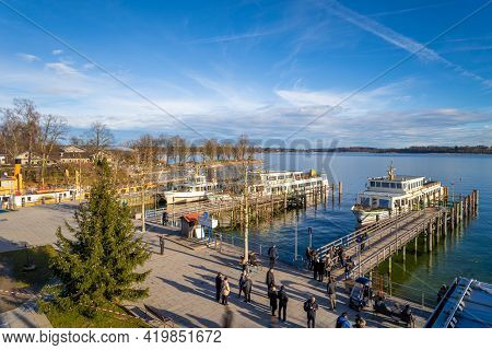 Prien Am Chiemsee, Germany - 15 December 2019 - Tourists Wait For Their Charter Boat To Visit The He