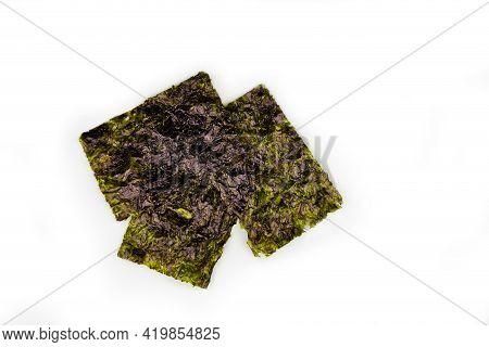 Crispy Nori Seaweed On White Background. Traditional Japanese Dry Seaweed Sheets.