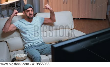 Player Man Holding Wireless Controller While Playing Videogames