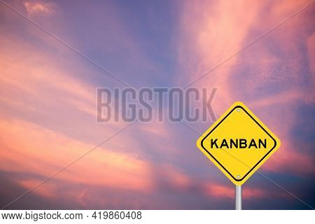 Yellow Transportation Sign With Word Kanban On Violet Sky Background