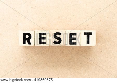 Alphabet Letter Block In Word Reset On Wood Background