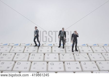 The Team Of Mini Figure Of Bodyguard On Keyboard