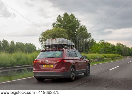 Godollo, Hungary. June 16, 2020. Red Volkswagen Tiguan Car With Gray Roof Luggage Box Driving On The