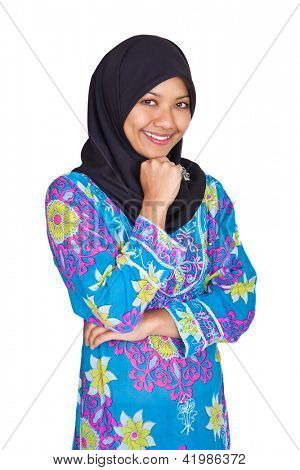 Beautiful young Muslim Malay woman in blue dress