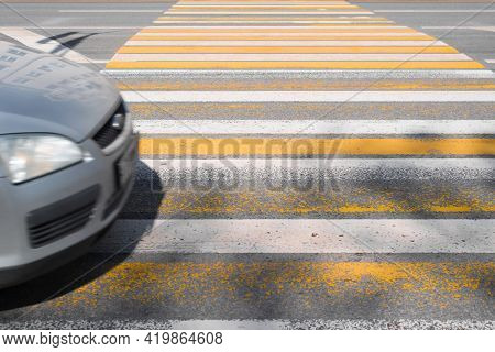 Pedestrian Crossing And Car Hood In Motion. Traffic Violation Concept,  Risk