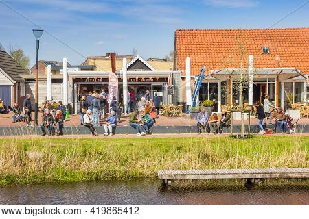 Eernewoude, Netherlands - April 27, 2021: People On Benches Enjoying The Spring Weather In Eernewoud