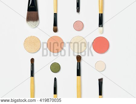 Various Professional Makeup Brushes With A Brown Handle, Lie Symmetrically On A White Background, Ar