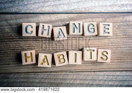Change Habits Written On Wooden Blocks On A Board