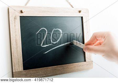 Number 20 Handwritten With Chalk On A Blackboard