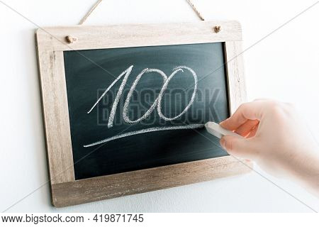 Number 100 Handwritten With Chalk On A Blackboard