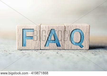 Faq Written On Wooden Blocks On A Board - Need Help Concept