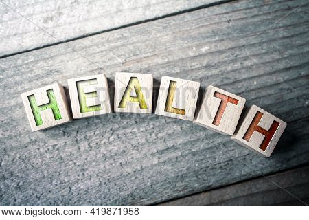 Curved Health Written On Wooden Blocks On A Board