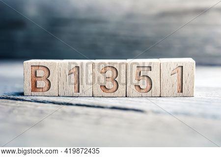 B1351 Sars-cov-2 Mutation Written On Wooden Blocks On A Board