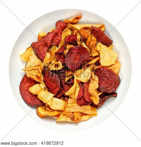Mixed Root Vegetable Crisps, In A White Bowl. Mix Of Sliced Root Vegetables, Parsnips, Beetroots And