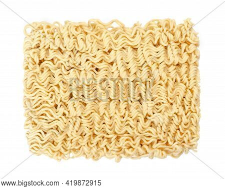 Dried Instant Noodle Block, From Above. Instant Ramen Are Noodles Sold In Precooked And Dried Block