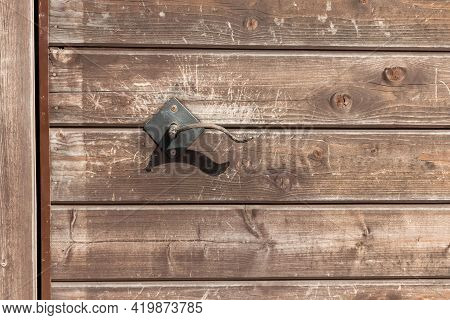 Wooden Door With Vintage Metal Handle. The Door Surface Is Made Of Wooden Horizontal Slats With A Wo