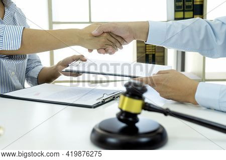 In The Law Firm, Business People Are Exchanging Contracts