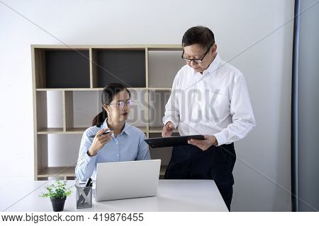 A Businessman Mentor Stand And Intern  Woman Staff Sit