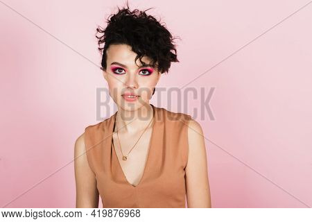 Portrait Of A Beautiful Model With Bright Pink Make-up And Bright Flying Hair. Beautiful Lips And Ma