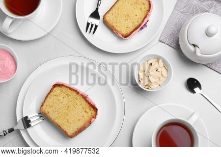 Tasty Breakfast With Sweet Cake And Aromatic Tea On White Table, Flat Lay