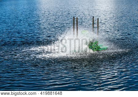 Paddle Wheels Aerators In Lake, Waste Water Treatment By Fill Oxygen Into Water. Evironmental Concep