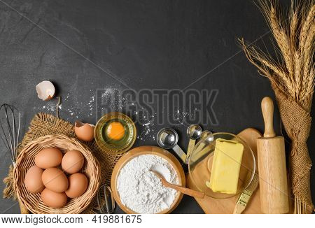 Bread Flour With Fresh Egg, Unsalted Butter And Accessories Bakery On Wood Background, Prepare For H