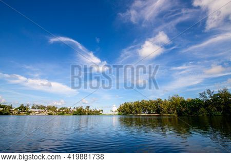White Cloud And Blue Sky On Lake At Bang Tao Beach Phuket Thailand In Sunny Day Travel Time Concept.