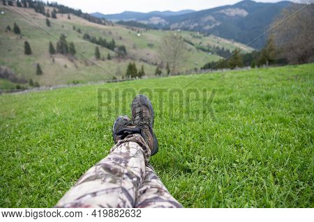 Feet And Legs On Green Meadow With Carpathian Mountains As A Background. Bucovina, Romania