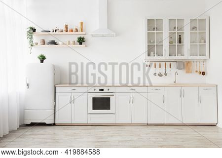 Minimal Light Scandinavian Kitchen Interior. White Furniture With Utensils, Shelves With Crockery, S