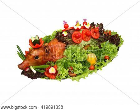 Roasted Piglet Decorated With Vegetables On Platter Isolated On White Background