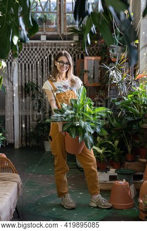House Garden And Plant Store Owner. Young Gardener Hold Houseplant Happy Smile. Love Of House Plants