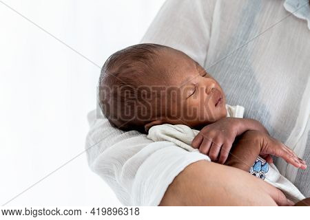 Portrait Images Of African, 12-day-old Baby Black Skin Newborn Son, Sleeping With His Mother Being H