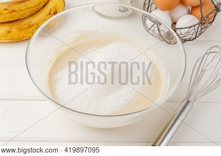 Cooking Oatmeal Pancakes With Bananas. Eggs, Buttermilk, Sugar, Vanilla, Oatmeal And Flour In A Bowl