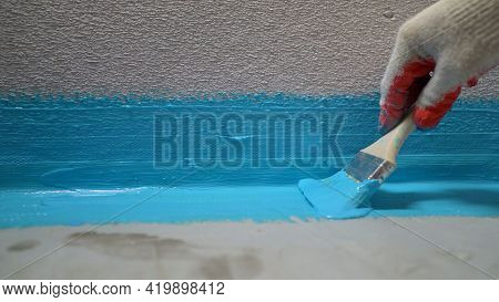 Cover The Concrete Wall With A Cement-polymer Waterproofing Membrane. Waterproofing With A Blue Shad