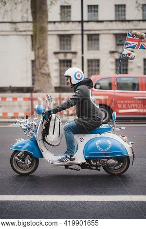 Westminster, London | Uk - 2021.05.08: Mods On Their Vespa And Lambretta Scooters Ride Through Parli